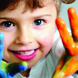 Child with painted hands - Little Friends Nursery